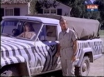 cheryl miller as paula tracy and marshall thompson as dr. marsh tracy in the jeep on daktari