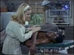 cheryl miller as paula tracy treats an injured man on daktari