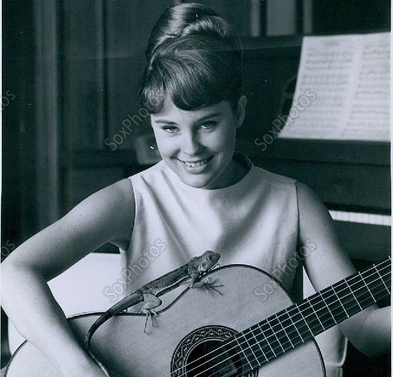 cheryl miller with her guitar-featured